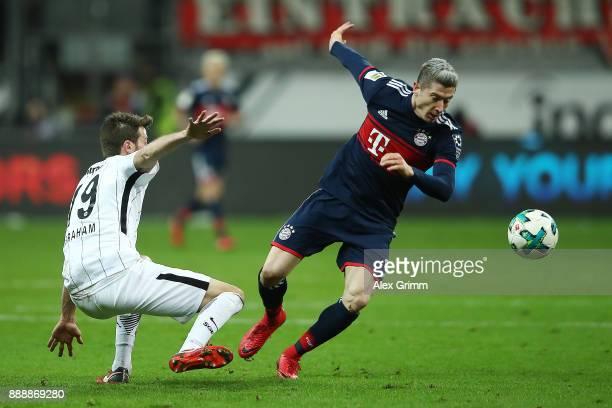Robert Lewandowski of Bayern Muenchen fights for the ball with David Abraham of Frankfurt during the Bundesliga match between Eintracht Frankfurt and...