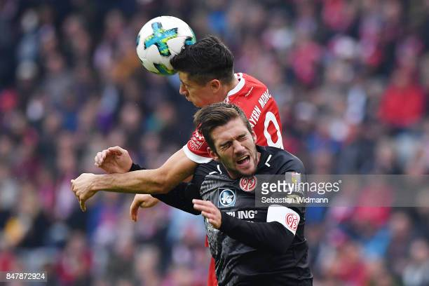 Robert Lewandowski of Bayern Muenchen fights for the ball with Stefan Bell of Mainz during the Bundesliga match between FC Bayern Muenchen and 1 FSV...
