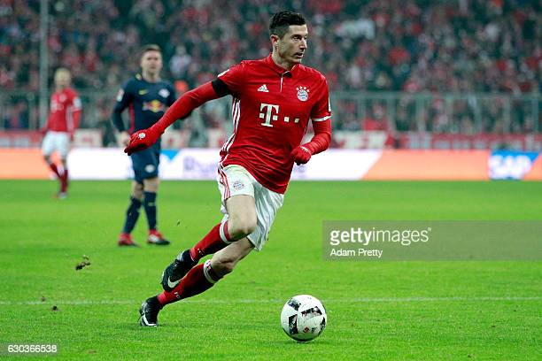 Robert Lewandowski of Bayern Muenchen in action during the Bundesliga match between Bayern Muenchen and RB Leipzig at Allianz Arena on December 21...