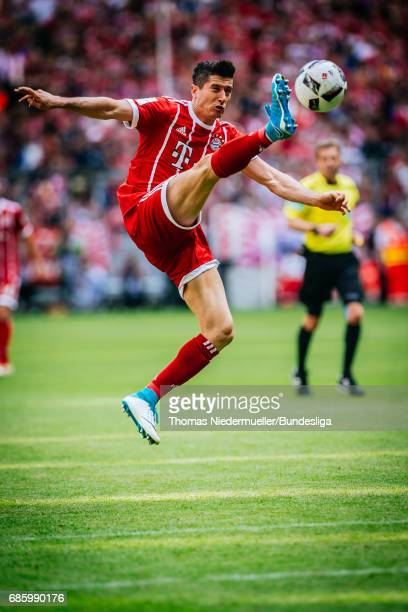 Robert Lewandowski of Bayern Muenchen in action with the ball during the Bundesliga match between Bayern Muenchen and SC Freiburg at Allianz Arena on...