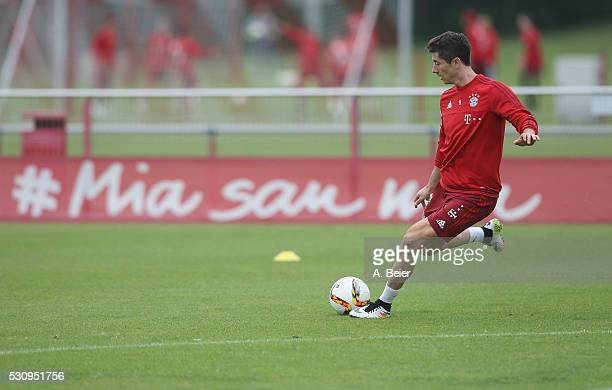 Robert Lewandowski of Bayern Muenchen kicks the ball during a training session at FC Bayern Muenchen training ground on May 12 2016 in Munich Germany