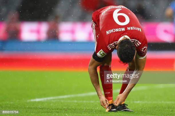 Robert Lewandowski of Bayern Muenchen radjust his football boots during the Bundesliga match between FC Bayern Muenchen and Bayer 04 Leverkusen at...