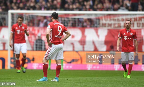 Robert Lewandowski of Bayern Muenchen reacts after the second goal of FSV Mainz 05 during the Bundesliga match between Bayern Muenchen and 1 FSV...