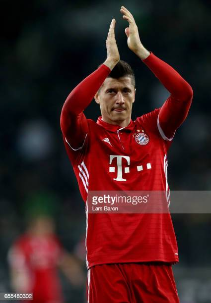 Robert Lewandowski of Bayern Muenchen reacts after winning the Bundesliga match between Borussia Moenchengladbach and Bayern Muenchen at BorussiaPark...