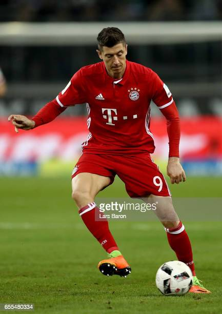 Robert Lewandowski of Bayern Muenchen runs with the ball during the Bundesliga match between Borussia Moenchengladbach and Bayern Muenchen at...