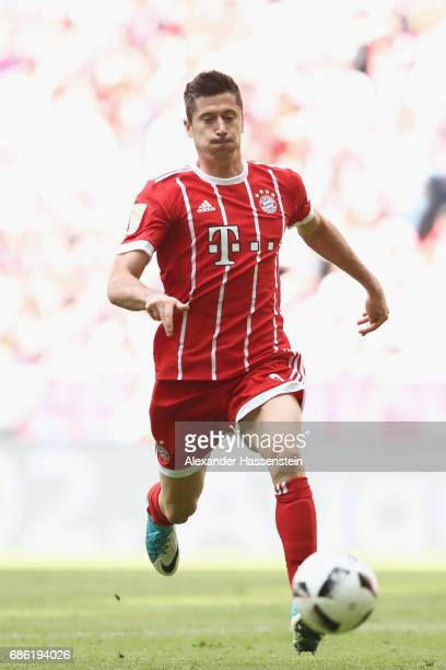 Robert Lewandowski of Bayern Muenchen runs with the ball during the Bundesliga match between Bayern Muenchen and SC Freiburg at Allianz Arena on May...