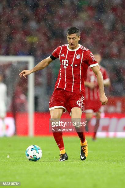 Robert Lewandowski of Bayern Muenchen runs with the ball during the Bundesliga match between FC Bayern Muenchen and Bayer 04 Leverkusen at Allianz...