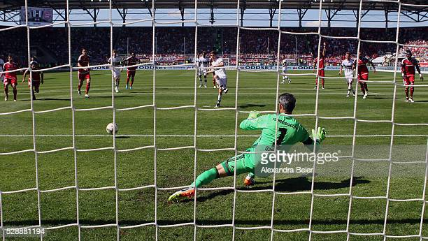 Robert Lewandowski of Bayern Muenchen scores a penalty goal against goalkeeper Ramazan Oezcan of FC Ingolstadt during the Bundesliga match between FC...