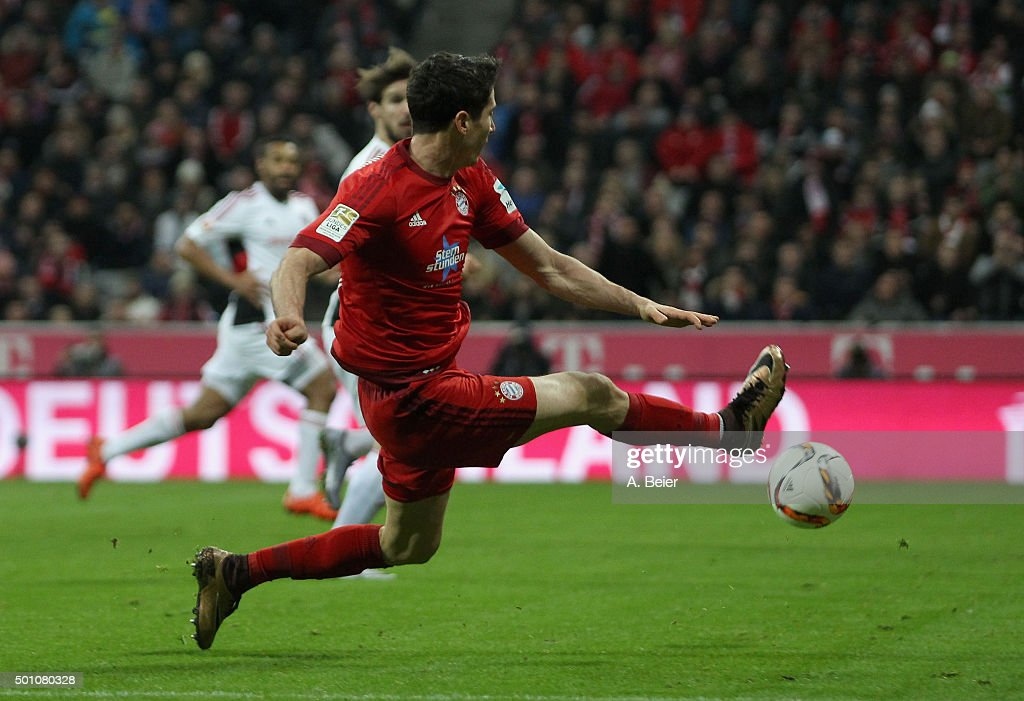 Robert Lewandowski of Bayern Muenchen scores his first goal during the Bundesliga match between FC Bayern Muenchen and FC Ingolstadt at Allianz Arena on December 12, 2015 in Munich, Germany.