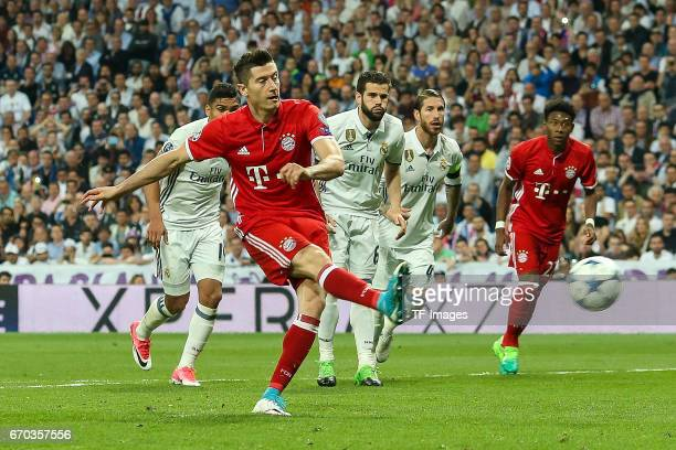 Robert Lewandowski of Bayern Muenchen scores his sides first goal from the penalty spot during the UEFA Champions League Quarter Final second leg...