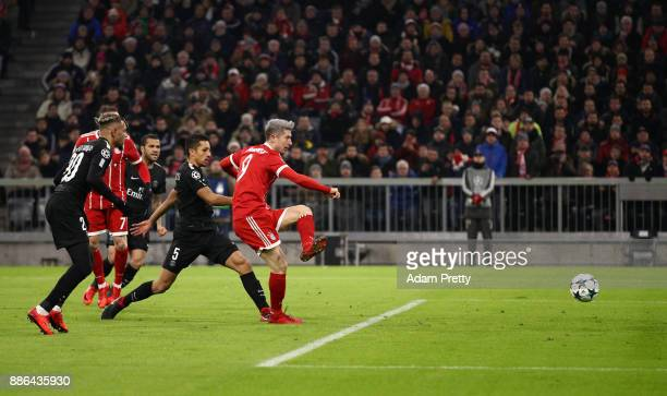 Robert Lewandowski of Bayern Muenchen scores his sides first goal during the UEFA Champions League group B match between Bayern Muenchen and Paris...