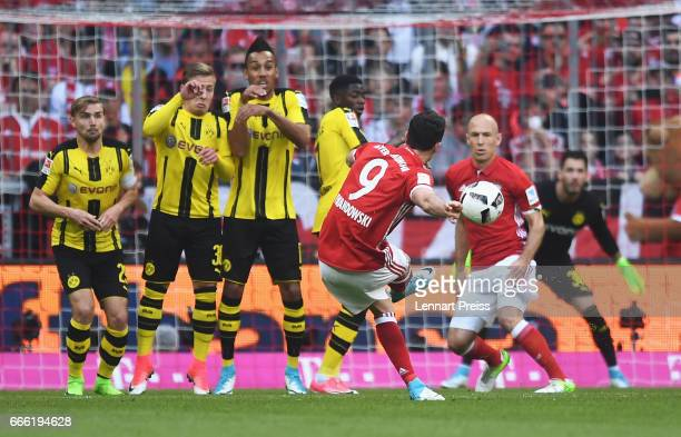 Robert Lewandowski of Bayern Muenchen scores his sides second goal during the Bundesliga match between Bayern Muenchen and Borussia Dortmund at...
