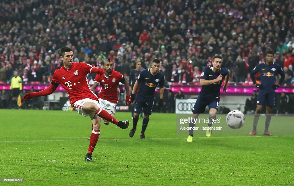 Robert Lewandowski of Bayern Muenchen scores his sides third goal from the penalty spot during the Bundesliga match between Bayern Muenchen and RB Leipzig at Allianz Arena on December 21, 2016 in Munich, Germany.