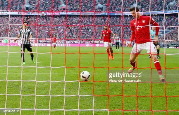 Robert Lewandowski of Bayern Muenchen scores his teams first goal during the Bundesliga match between Bayern Muenchen and Eintracht Frankfurt at...