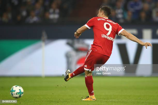 Robert Lewandowski of Bayern Muenchen scores his teams first goal from the penalty spot to make it 10 during the Bundesliga match between FC Schalke...