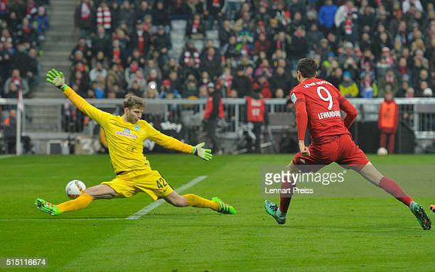 Robert Lewandowski of Bayern Muenchen scores his team's fourth goal against Felix Wiedwald of Werder Bremen during the Bundesliga match between FC...
