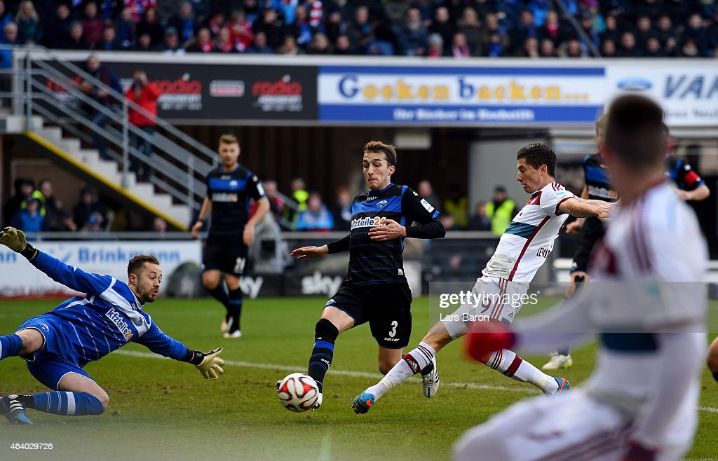Robert Lewandowski of Bayern Muenchen scores his teams second goal during the Bundesliga match between SC Paderborn and FC Bayern Muenchen at...