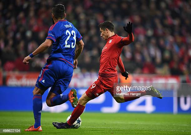 Robert Lewandowski of Bayern Muenchen scores his teams second goal during the UEFA Champions League group F match between FC Bayern Munchen and...