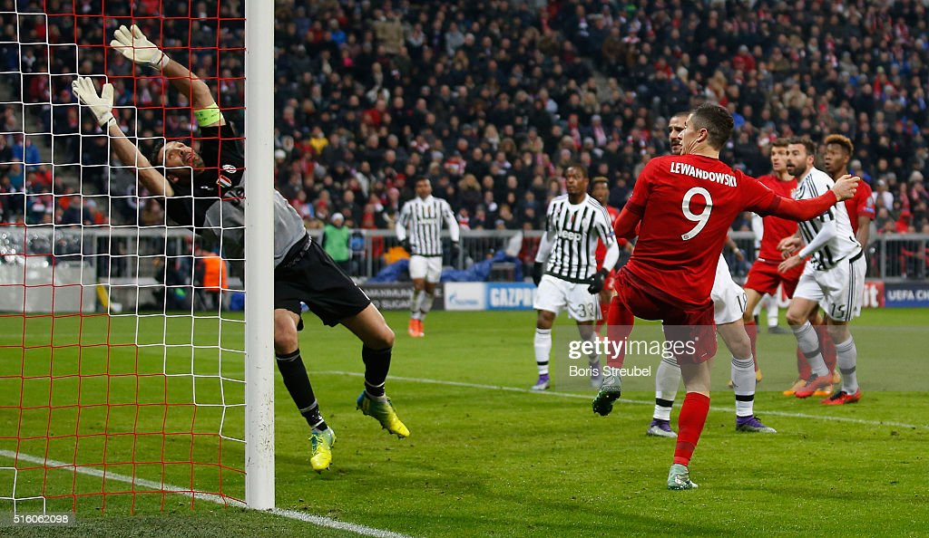 Robert Lewandowski of Bayern Muenchen scores his team's second goal against goalkeeper Gianluigi Buffon during the UEFA Champions League round of 16 second leg match between FC Bayern Muenchen and Juventus Turin at Allianz Arena on March 16, 2016 in Munich, Germany.