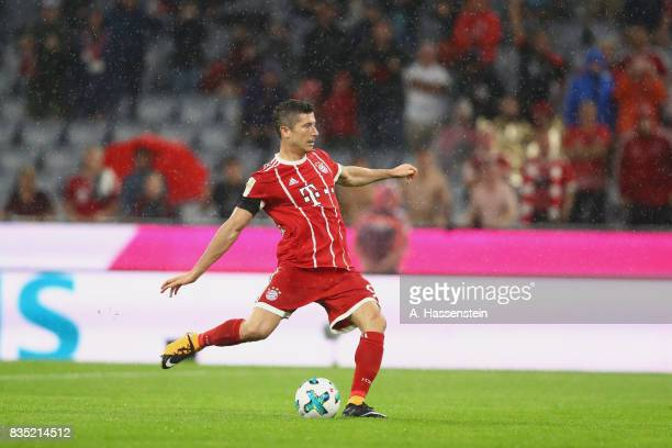 Robert Lewandowski of Bayern Muenchen scores the 3rd team goal with a penalty during the Bundesliga match between FC Bayern Muenchen and Bayer 04...