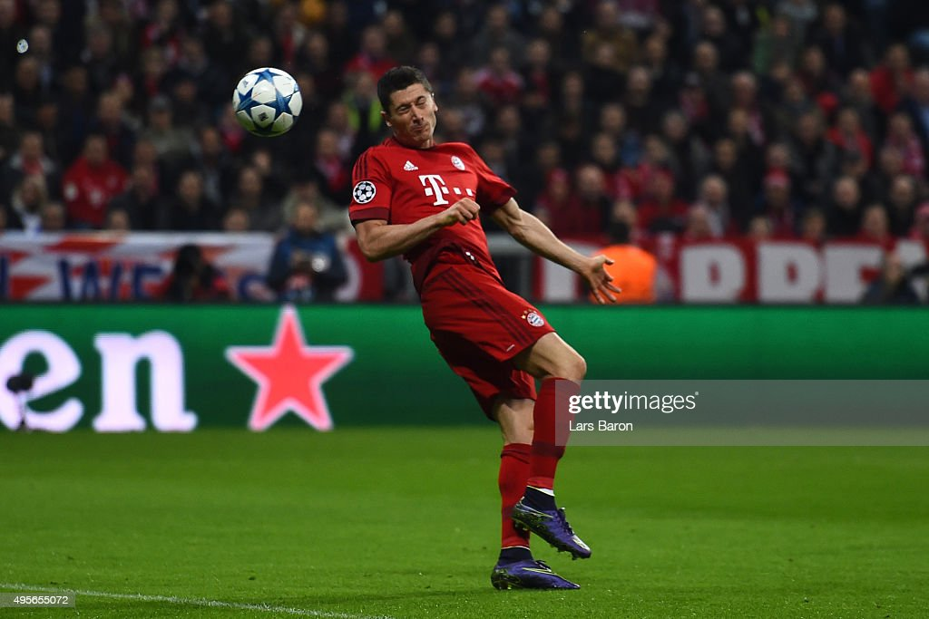 Robert Lewandowski of Bayern Muenchen scores the opening goal during the UEFA Champions League Group F match between FC Bayern Muenchen and Arsenal FC at the Allianz Arena on November 4, 2015 in Munich, Germany.