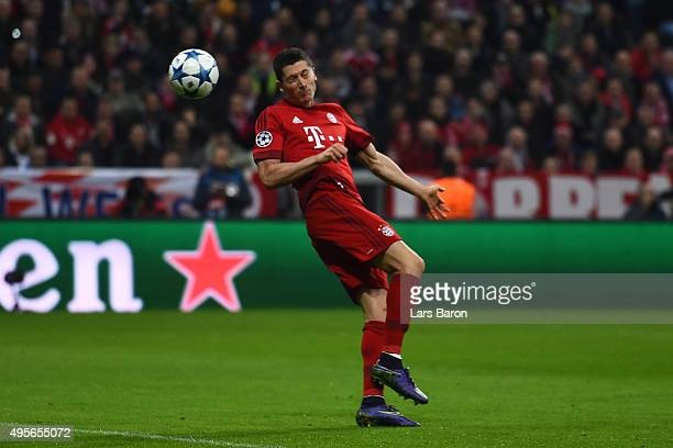 Robert Lewandowski of Bayern Muenchen scores the opening goal during the UEFA Champions League Group F match between FC Bayern Muenchen and Arsenal...