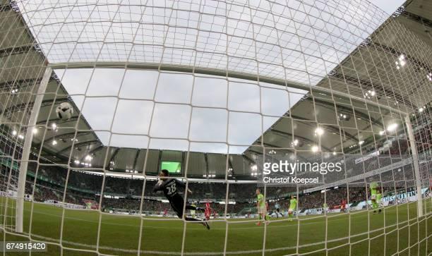 Robert Lewandowski of Bayern Muenchen scores the second goal against Koen Casteels of Wolfsburg during the Bundesliga match between VfL Wolfsburg and...