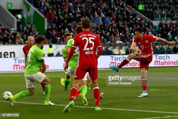 Robert Lewandowski of Bayern Muenchen scores the third goal during the Bundesliga match between VfL Wolfsburg and Bayern Muenchen at Volkswagen Arena...