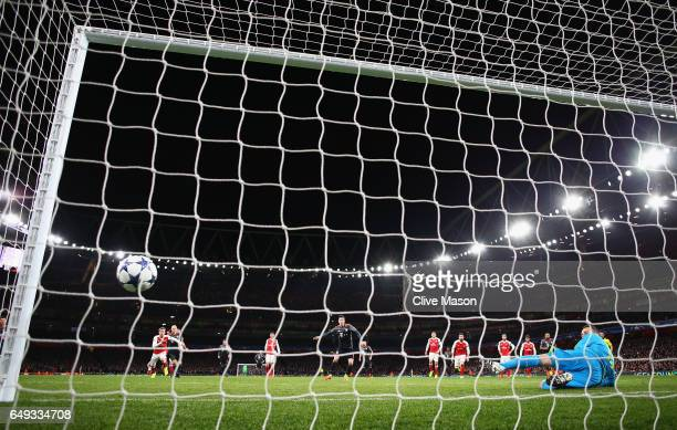 Robert Lewandowski of Bayern Muenchen scores their first goal past goalkeeper David Ospina of Arsenal from a penalty during the UEFA Champions League...