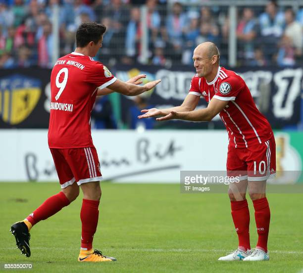 Robert Lewandowski of Bayern Muenchen shakes hands with Arjen Robben of Bayern Muenchen during the DFB Cup first round match between Chemnitzer FC...