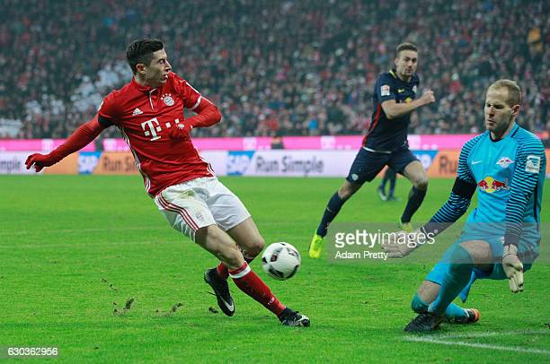 Robert Lewandowski of Bayern Muenchen shoots but Peter Gulacsi of RB Leipzig saves during the Bundesliga match between Bayern Muenchen and RB Leipzig...