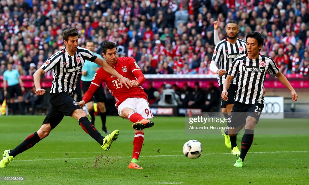 Robert Lewandowski of Bayern Muenchen shoots on goal during the Bundesliga match between Bayern Muenchen and Eintracht Frankfurt at Allianz Arena on March 11, 2017 in Munich, Germany.