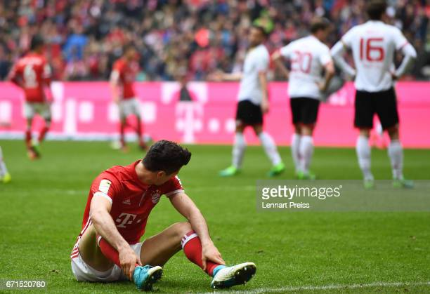 Robert Lewandowski of Bayern Muenchen sits on the pitch during the Bundesliga match between Bayern Muenchen and 1 FSV Mainz 05 at Allianz Arena on...