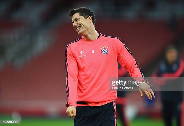 Robert Lewandowski of Bayern Muenchen smiles during a Bayern Munchen training session ahead of the UEFA Champions League match against Arsenal at...