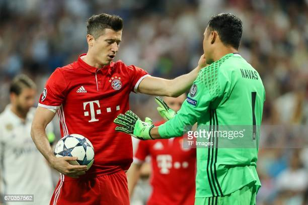 Robert Lewandowski of Bayern Muenchen speak with Goalkeeper Keylor Navas of Real Madrid during the UEFA Champions League Quarter Final second leg...