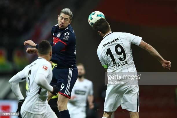 Robert Lewandowski of Bayern Muenchen takes a header against David Abraham of Frankfurt during the Bundesliga match between Eintracht Frankfurt and...