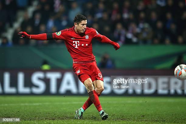 Robert Lewandowski of Bayern Muenchen takes a shot at goal during the DFB Cup quarter final match between VfL Bochum and Bayern Muenchen at...