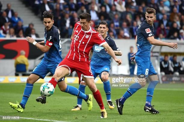 Robert Lewandowski of Bayern Muenchen while Benjamin Huebner of Hoffenheim and Havard Nordtveit of Hoffenheim look on during the Bundesliga match...