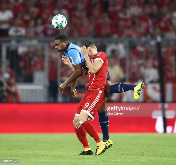 Robert Lewandowski of Bayern Muenchen with Jonathan Tah of Bayer Leverkusen during the Bundesliga match between FC Bayern Muenchen and Bayer 04...