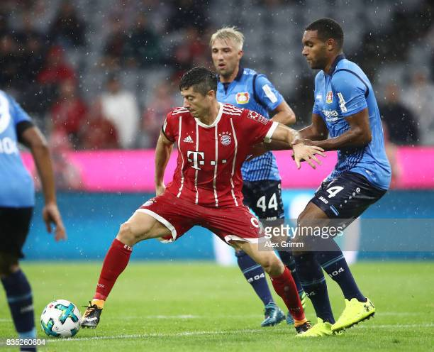 Robert Lewandowski of Bayern Muenchen with Jonathan Tah of Bayer Leverkusen while Kevin Kampl of Bayer Leverkusen looks on during the Bundesliga...