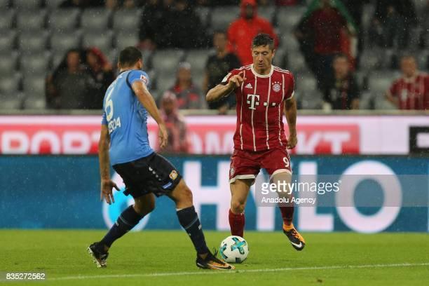 Robert Lewandowski of Bayern Munich and Aleksandar Dragovic of Bayer 04 Leverkusen vie for the ball during the German First division Bundesliga...