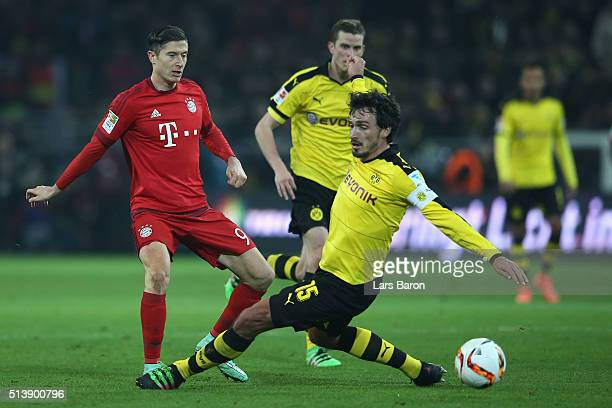 Robert Lewandowski of Bayern Munich and Mats Hummels of Borussia Dortmund compete for the ball during the Bundesliga match between Borussia Dortmund...