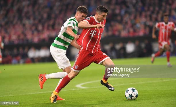 Robert Lewandowski of Bayern Munich and Mikael Lustig of Celtic FC vie for the ball during the Champions League group B soccer match between FC...