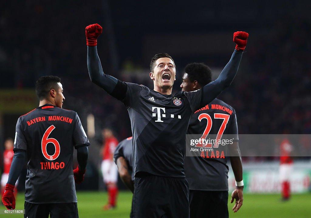 Robert Lewandowski of Bayern Munich celebrates after scoring a penalty goal during the Bundesliga match between 1. FSV Mainz 05 and Bayern Muenchen at Opel Arena on December 2, 2016 in Mainz, Germany.