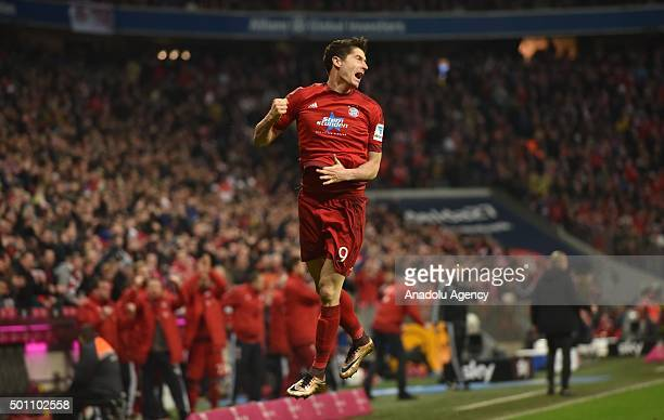 Robert Lewandowski of Bayern Munich celebrates after scoring during the Bundesliga soccer match between FC Bayern Munich and FC Ingolstadt 04 at the...