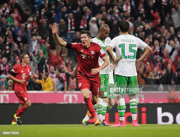 Robert Lewandowski of Bayern Munich celebrates after scoring his 5th goal during the Bundesliga match between FC Bayern Muenchen and VfL Wolfsburg at...