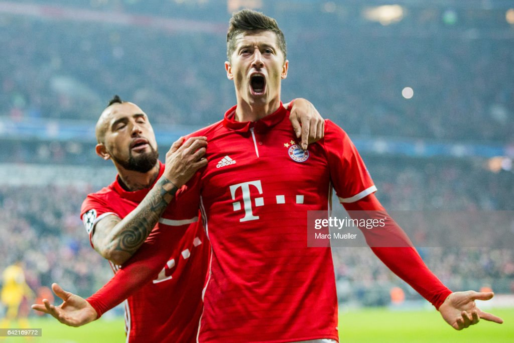 Robert Lewandowski (R) of Bayern Munich celebrates after scoring his team's second goal together with Arturo Vidal during the UEFA Champions League Round of 16 first leg match between FC Bayern Muenchen and Arsenal FC at Allianz Arena on February 15, 2017 in Munich, Germany.