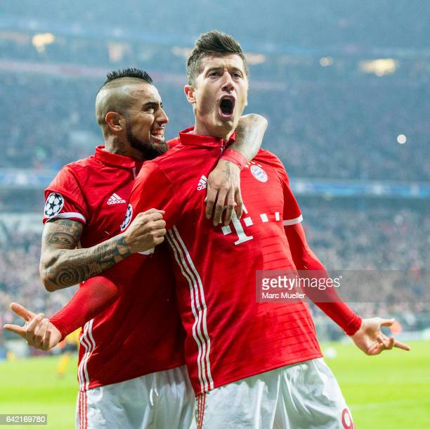 Robert Lewandowski of Bayern Munich celebrates after scoring his team's second goal together with Arturo Vidal during the UEFA Champions League Round...