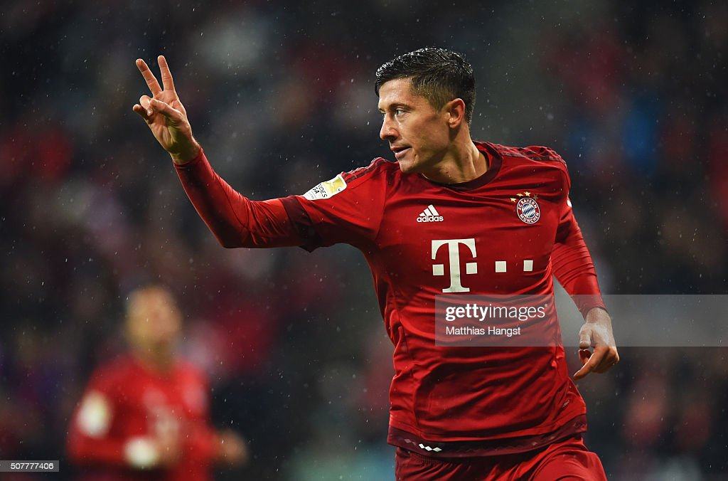 <a gi-track='captionPersonalityLinkClicked' href=/galleries/search?phrase=Robert+Lewandowski&family=editorial&specificpeople=5532633 ng-click='$event.stopPropagation()'>Robert Lewandowski</a> of Bayern Munich celebrates as he scores his and the team's second goal during the Bundesliga match between FC Bayern Muenchen and 1899 Hoffenheim at Allianz Arena on January 31, 2016 in Munich, Germany.