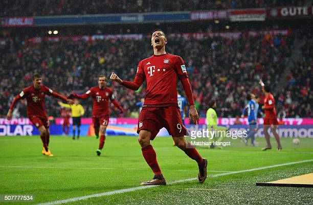 Robert Lewandowski of Bayern Munich celebrates as he scores his and the team's second goal during the Bundesliga match between FC Bayern Muenchen and...